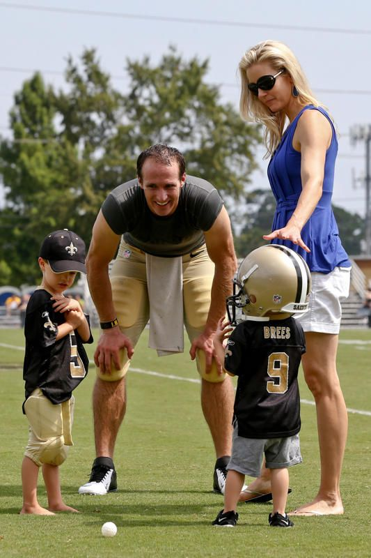 New Orleans Saints quarterback Drew Brees (9) and wife Brittany Brees with their kids Baylen Brees and Bowen Brees (wearing helmet) following a scrimmage at the team training facility. Mandatory Credit: Derick E. Hingle-USA TODAY Sports