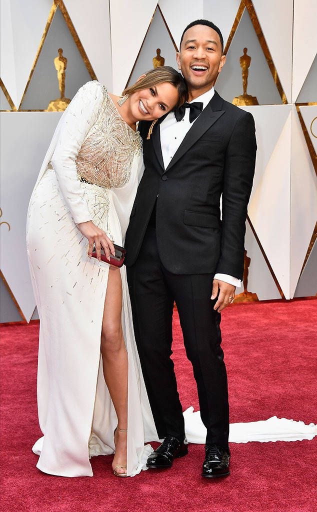 Chrissy Teigen & John Legend from Oscars 2017: Red Carpet Couples  The superstar couple flashes a couple of superstar smiles.