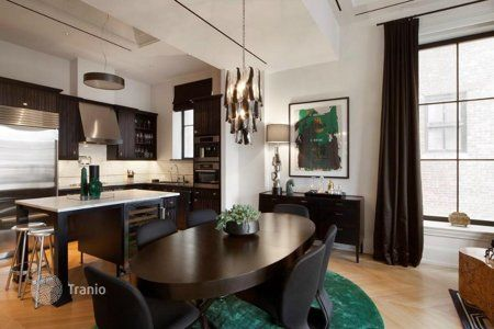 A rare combination of colors: dark chocolate and emerald. Dramatic, spectacular and memorable interior.