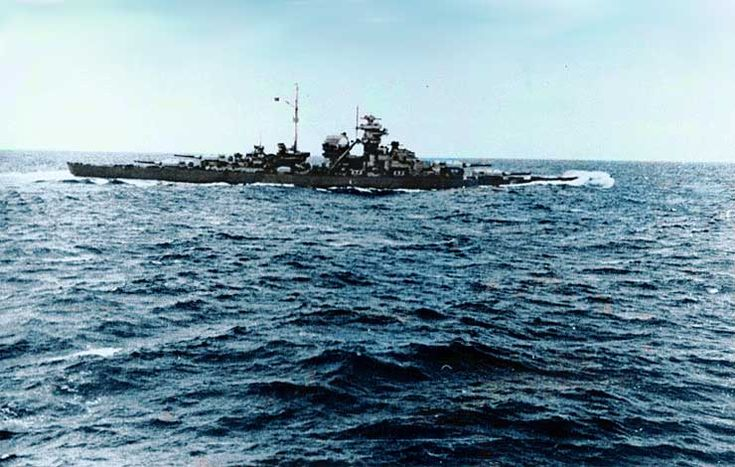 Battleship Bismarck after the Battle of the Denmark Strait. She was flooded forward and is down at the head by about two meters. Still able to do 28 knots, though. Taken from the Prinz Eugen.