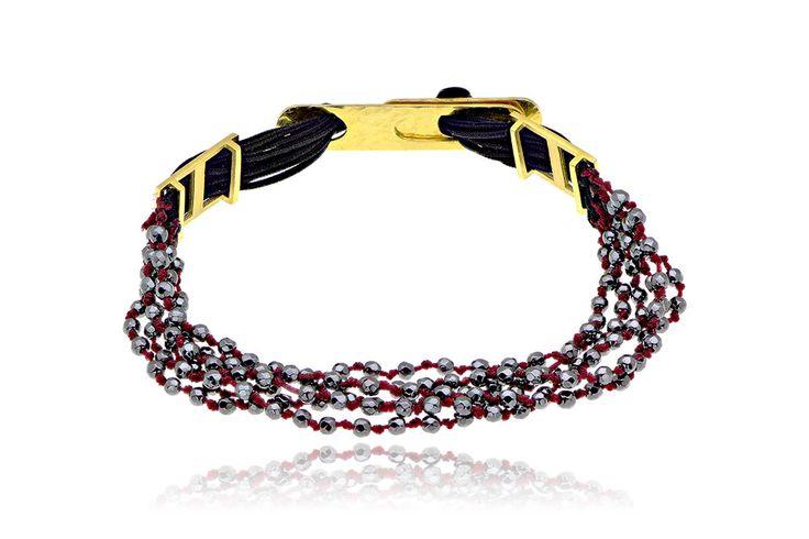 Πλεκτό βραχιόλι με αιματίτη από επιχρυσωμένο ασήμι 925 με αιματίτη. Knitted bracelet with hematite made by yellow gold-plated silver 925. Price : 130 €