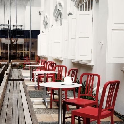 Red Emeco 111 Navy chairs at outdoor café within Space Asia Hub. The retail environment spans 40,000 sq ft across three blocks at Bencoolen street in the midst of the arts and entertainment district of Singapore. The Emeco 111 Navy Chairs is made of #recycled Coca-Cola bottles. photo by Patrick Bingham-Hall.