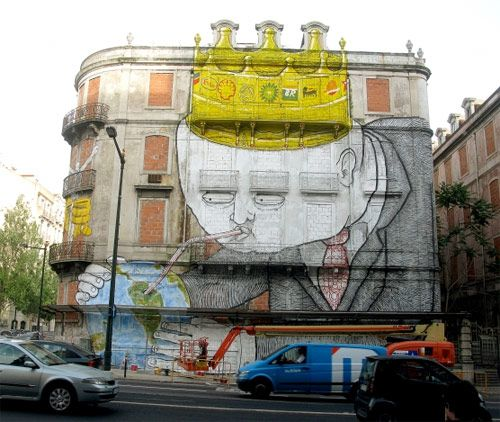 Beautiful new work from Os Gemeos and Blu in Lisboa, Portugal.