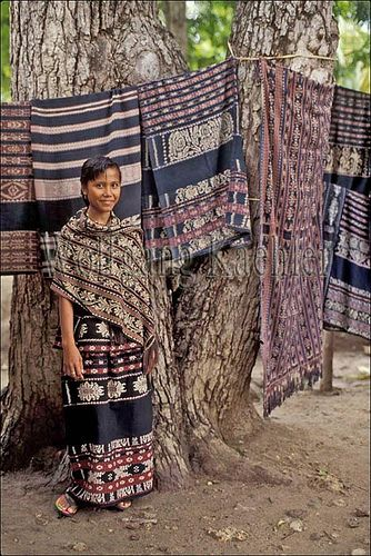 Indonesia, sawu (Seba) Island village, display of traditional ikat weavings, local girl