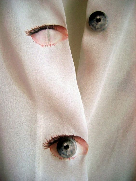 """""""All Seeing Eye buttons, created by artist Elodie Antoine and Loved by photographer Olena Slyesarenko, are in the form of an exquisitely detailed eye socket and eyeball – which unite when fastened to truly uncanny effect."""":"""