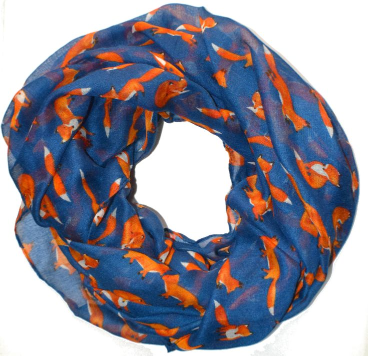The Fancy Fox Infinity Scarf is the perfect accessory for fox fans! Light and soft, you're going to find yourself wanting to wear this all the time! Width: 40in. Length: 85in. For best results on frin