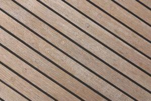 Teak slats make a strong and water-proof shower floor.