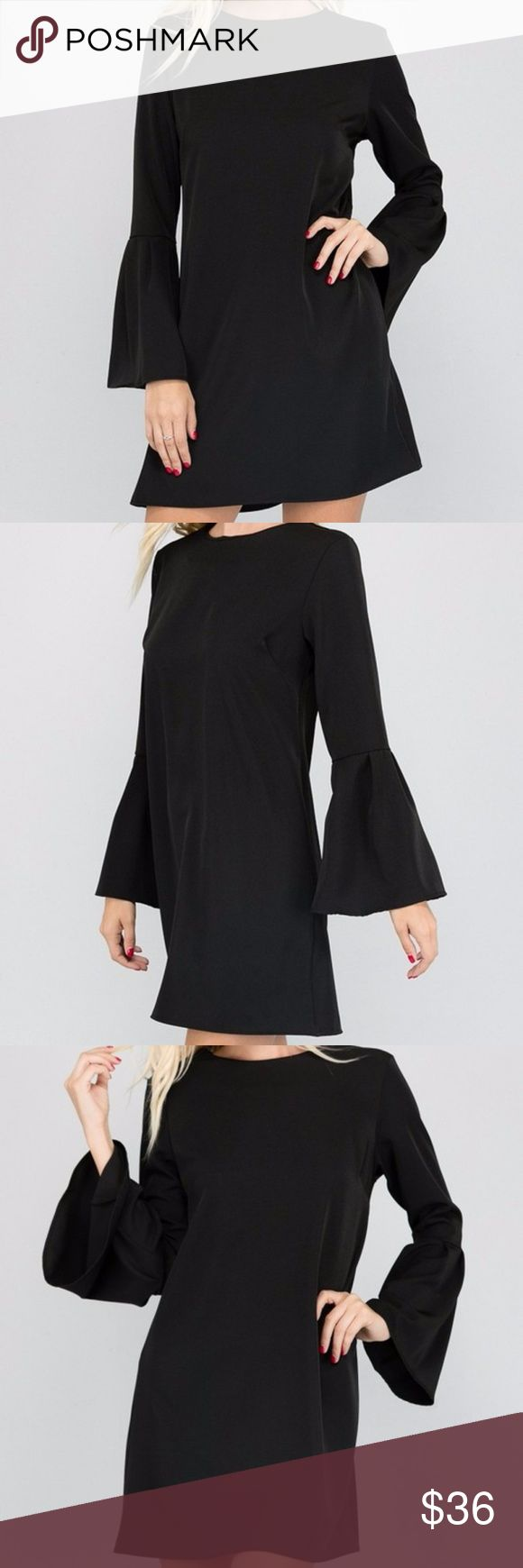 Black Long Bell Sleeve Mini Shift Dress Tunic Top Black long Bell Sleeve mini Dress or Tunic Top. Hidden zipper back closure. Made of soft stretchy crepe fabric. Polyester spandex blend. Made in USA. Brand New factory direct.  Size S 2/4: Bust 33-34 Waist 25-26 Hips 35-36 Size M 6/8: Bust 35-36 Waist 27-28 Hips 37-38 Size L 10/12: Bust 37-38 Waist 29-30 Hips 39-40  Size chart provided as a guidance. Dresses Mini