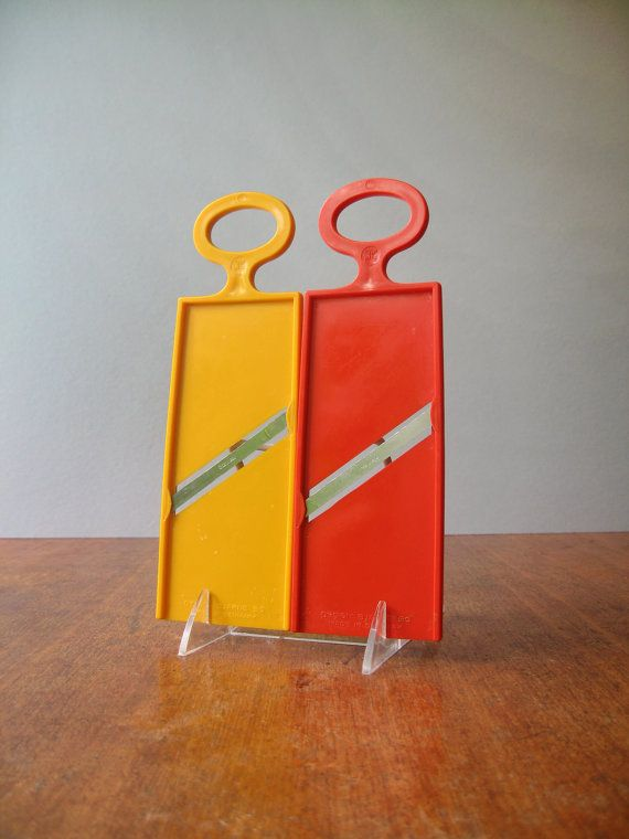 Pair of stylish Bjarne Bo Danish modern yellow and dark orange plastic food slicers. Stainless steel blades are sharp and cut well, creating a very thin slice. I am honoring these excellent slicers here, because I cannot find them anywhere, in the whole wide World...and I miss mine.