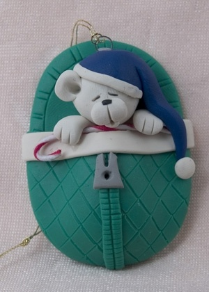 I would make each of the kids one with their name on their little night cap. (polymer clay ornament)