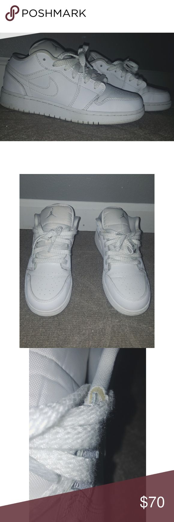 Nike air Jordan 1 All white lowtop air Jordan's. Has a small tear on the top left shoe wear the shoe lace ends. Size 5 youth. Air Jordan Shoes Sneakers