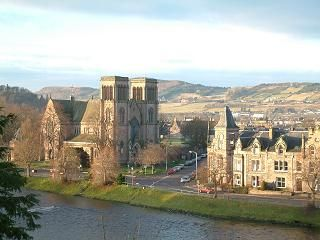 Inverness, Scotland.  I've been to Edinburgh & Glasgow and loved them both.  But Inverness is the main city of the Highlands and it is my goal some day to see all the castles, Loch Ness, Culloden Battlefield and Inverness city herself.