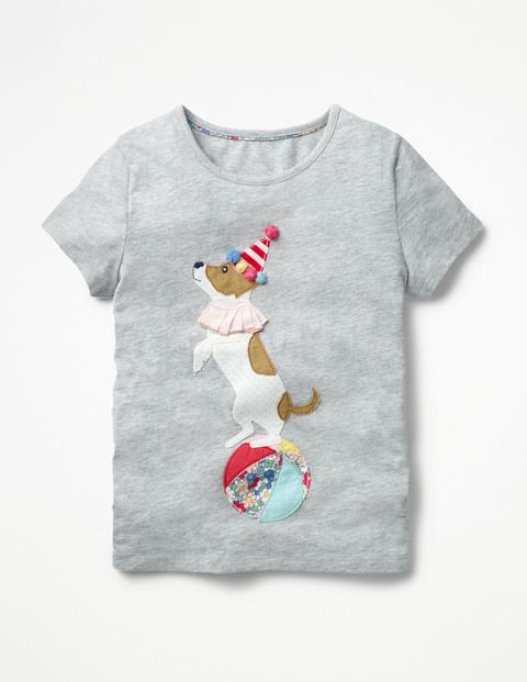 Roll up, roll up – marvel at the amazing performing animals on this charming circus-themed T-shirt. The soft cotton design has short sleeves and a crew neck, with playful appliqué detailing of a plumed horse, balancing dog or musical mouse.