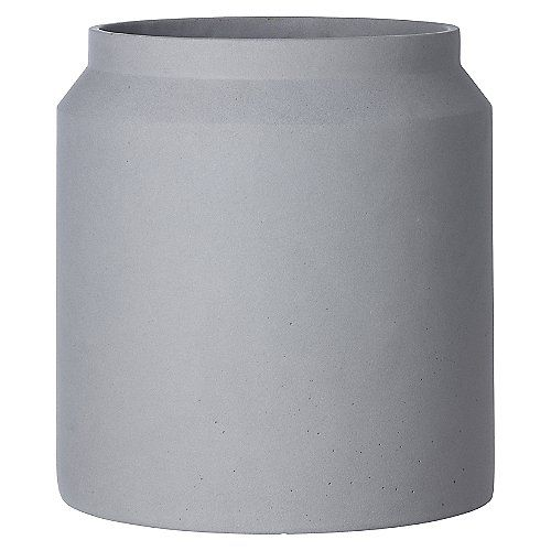 The Ferm Living Concrete Pot - Light Grey is great for minimalists and design enthusiasts alike. Made entirely of concrete, the modern geometric form is created with an unexpected material yet still reads modern. Suitable for both indoor and outdoor use, bring a little urban flair into your living space whether that be in a busy city or not.