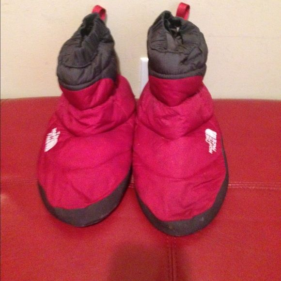 The North Face 700 Fill down Slippers tent Booties Gently worn. Size (M). Fits size 9/10. Color (Red/ Gray). Worn a couple of times around the house. No rips or odors.   Please ask questions before purchasing. Additional pics per your request.     Bundle and save                                            Same/Next day Shipping  Pay Pal  Trades  No Haggling   Free home  Free home  Thanks for checking out my closet The North Face Shoes Slippers