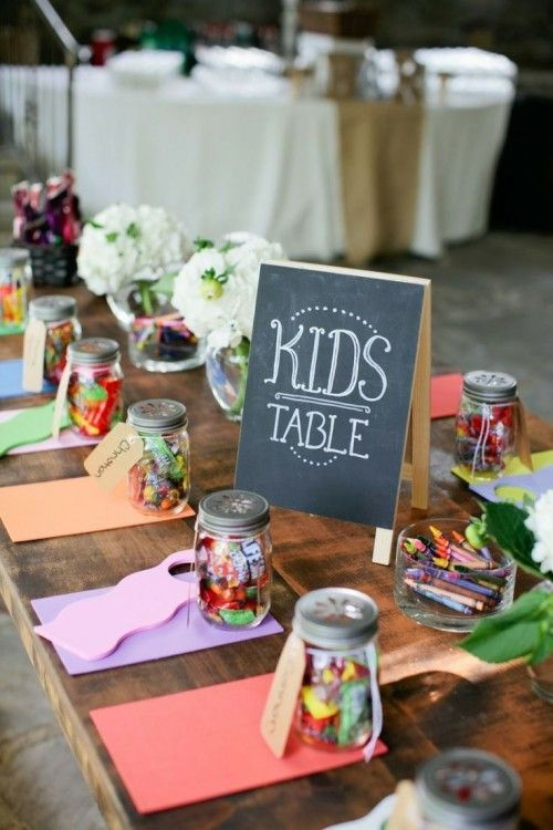 great idea to keep kids entertained at your wedding. give them some crafts and a jar filled with candy treats.