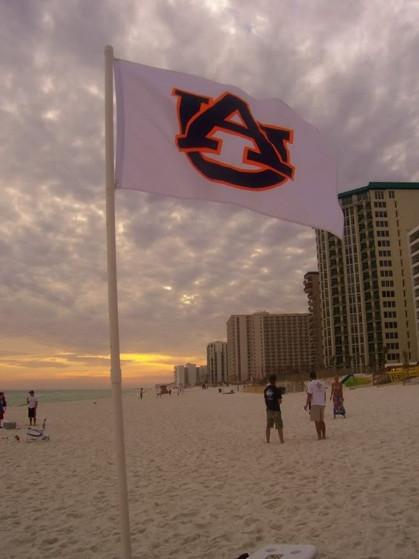 My happy place - Orange Beach with an Auburn flag. WDE.