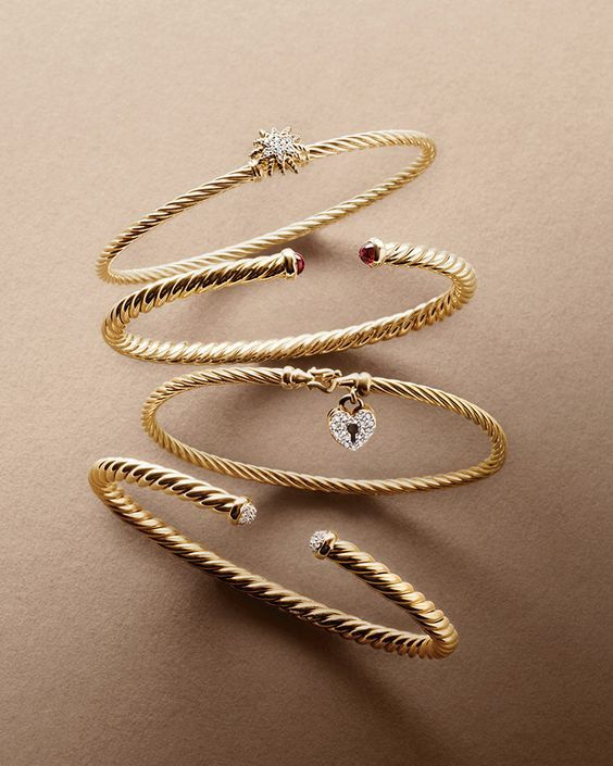 David Yurman bracelets in 18k gold.