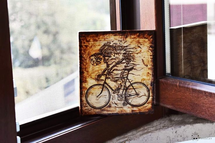 Handmade pyrography art picturing the endless love for cycling