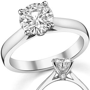 like the small diamond at base.  Round Brilliant Moissanite Solitaire w/ Surprise Diamonds