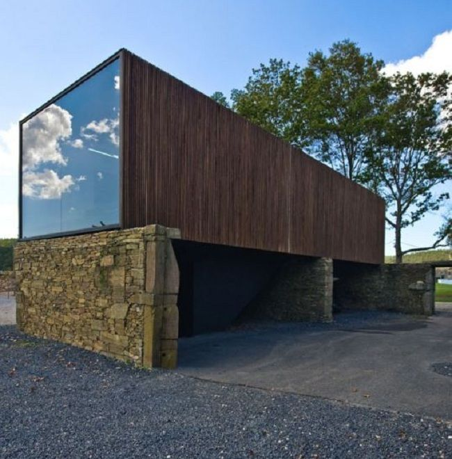 A Wooden Sided Container Sits Atop An Existing Stone