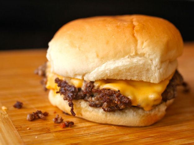 This is the ultimate burger for single men. Don't cook it for company (the recipe only works for one burger at a time anyway). Don't cook it unless you are prepared to have your apartment smelling like a burger joint for days. Don't cook it if you want anything less than the crispiest, beefiest, saltiest, greasiest, gooiest burger experience you've ever had. This is a burger can make you, like me, break your vows.