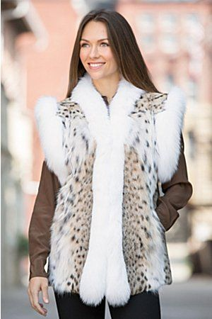 This royal design dresses you in the warmth and beauty of natural lynx fur, lavishly trimmed with beautiful white fox fur from Finland.