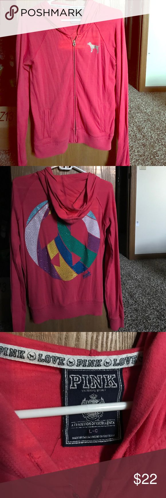 PINK Victoria's secret hooded zip up jacket Hot pink VS zip up jacket, multicolor rhinestone peace sign on back, pockets in front, women's size large, fits true to size, only worn a few times, still in great condition, super light weight and comfy! PINK Victoria's Secret Tops Sweatshirts & Hoodies