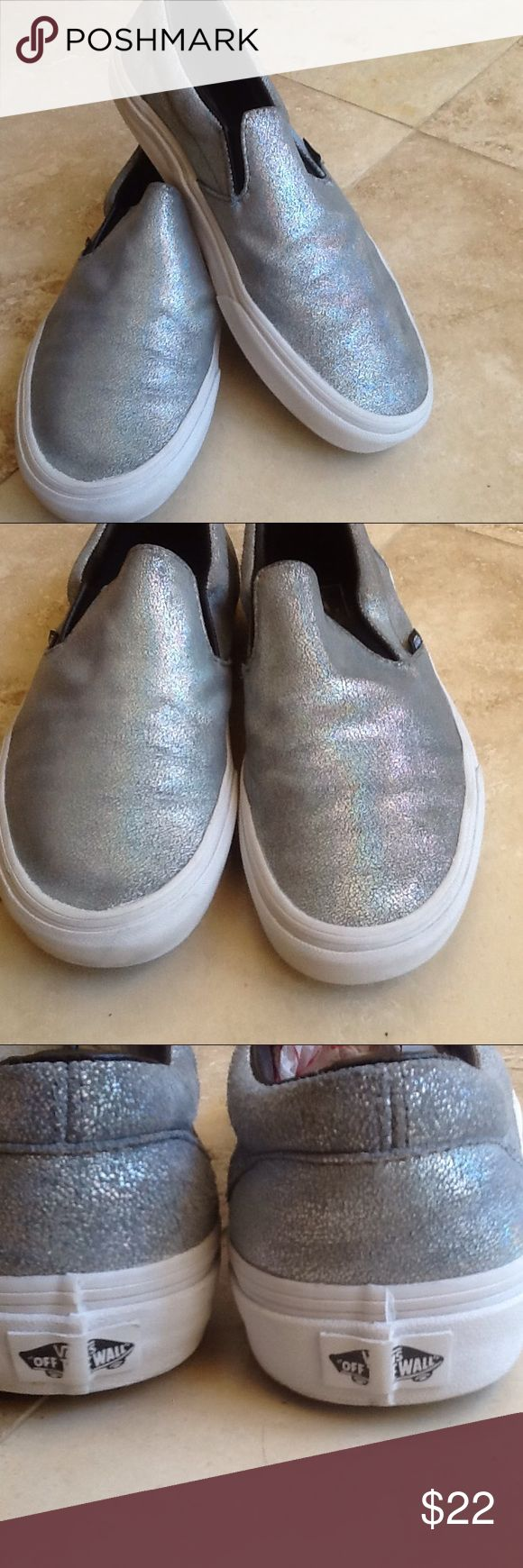 VANS silver metallic slip ons Ladies size 10... Silver slip ons. In great condition. Ask for more info or pictures if needed before buying. Priced low for quick sale..PRICE FIRM Vans Shoes Sneakers