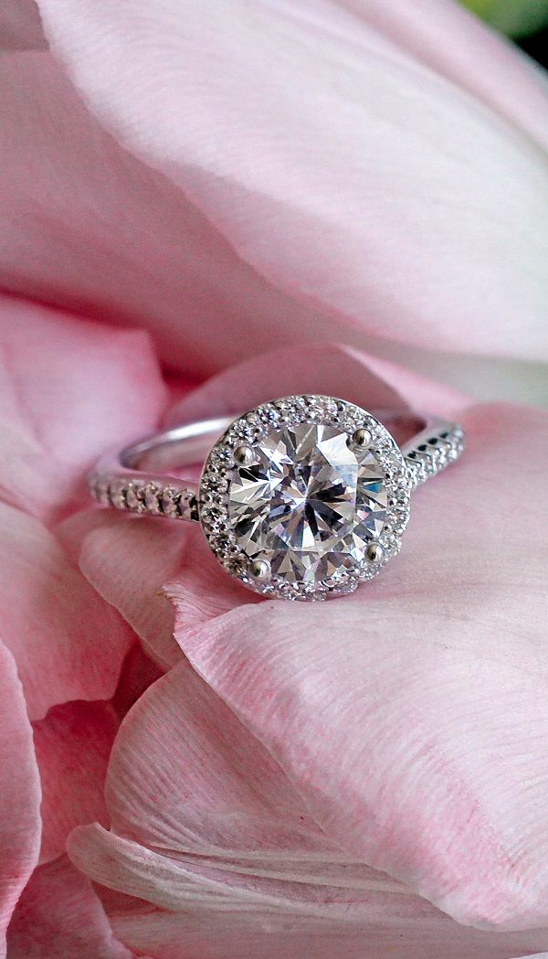 Halo Diamond Ring with Side Stones. Side stones are stunning!!