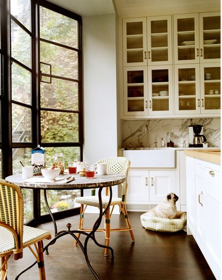 gorgeous windows, love those chairs and the white cabinets, but the best part has to be the pug | La Dolce Vita