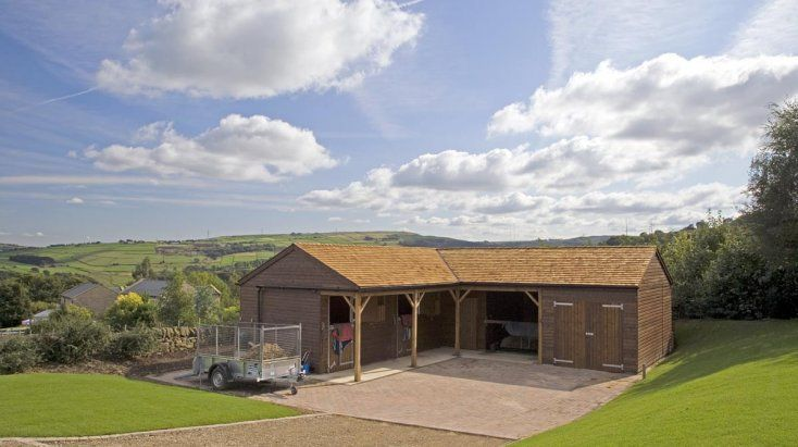 Two stables, tack room, hay store and store room designed and built by The Stable Company.