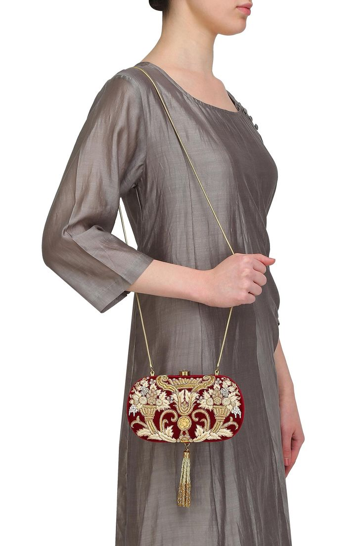 Rust beads and dabka zardosi embroidered oval box clutch with bead tassel available only at Pernia's Pop Up Shop.