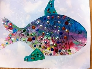 Preschool Art project: Draw fishes beforehand on paper, students paint and decorate with sequins.  While that is drying, students can paint a background of the ocean.  Maybe glue on yarn for seaweed along the bottom?