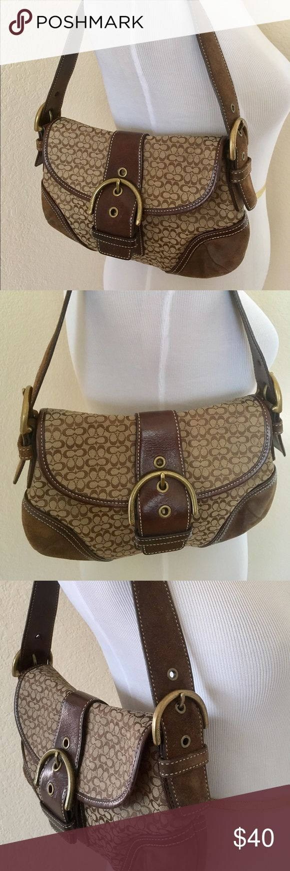 Coach brown monogram bag with suede accents Coach brown monogram bag with suede accents. In good used condition. Inside 2 compartments . Size 10x 8 . Suede shows some wear , one scratch on leather strap in back . In overall good condition, it has a lot of use to it left . Clean inside . Coach Bags Shoulder Bags