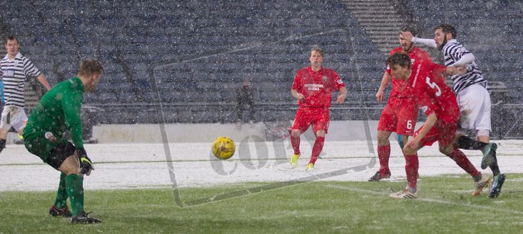 Queen's Park's John Carter hits the ball past Montrose keeper Jordan Millar during the SPFL League Two game between Queen's Park and Montrose.