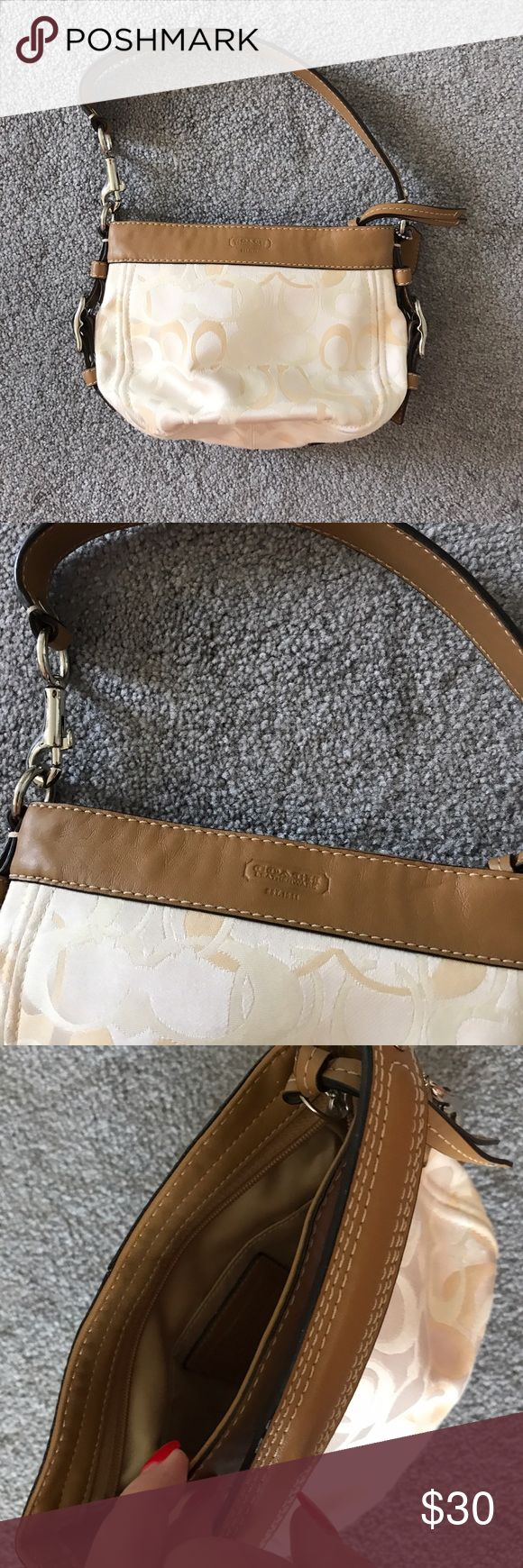 Tan Signature Coach Purse Authentic Tan Coach purse in great condition, one flaw, small pen mark (see photo). Signature Coach logos throughout Bag. Tan and beige in color. Coach Bags Shoulder Bags