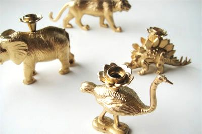 spray paint plastic animals/candle holders gold  and make cupcake toppers