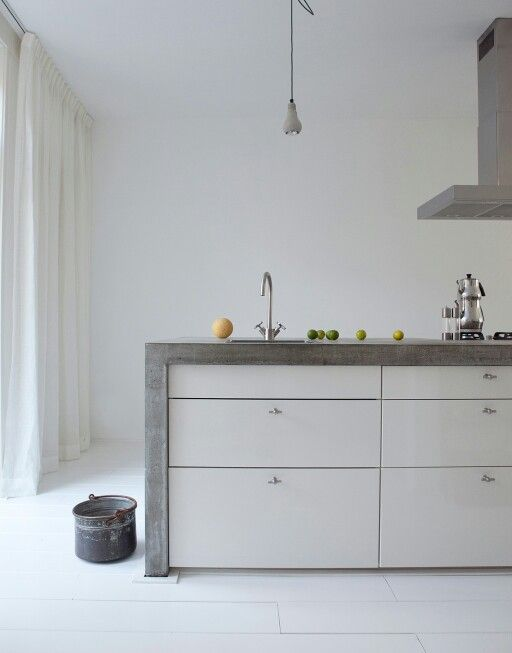 The white cabinets soften the concrete island.  I think I'd rather see wood/plywood or perhaps brushed metal though.