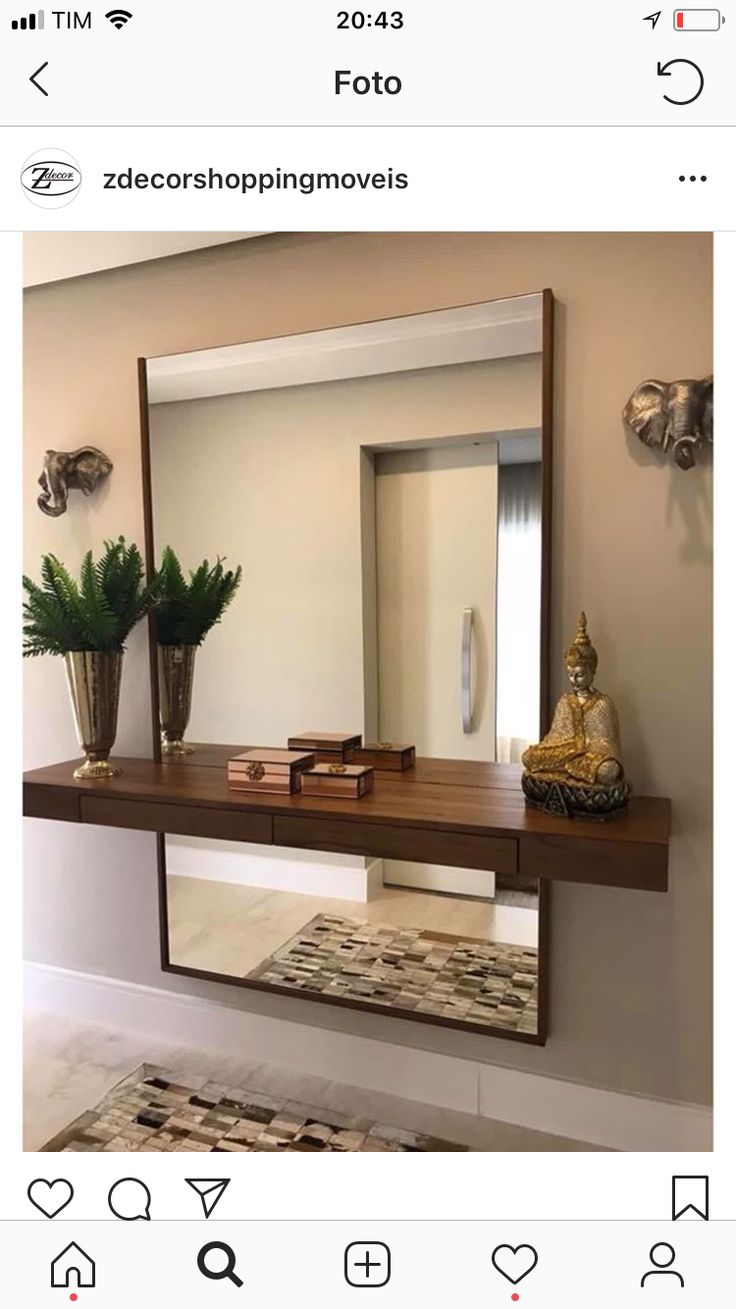 Floating Shelf And Large Mirror On Wall Behind Shelf