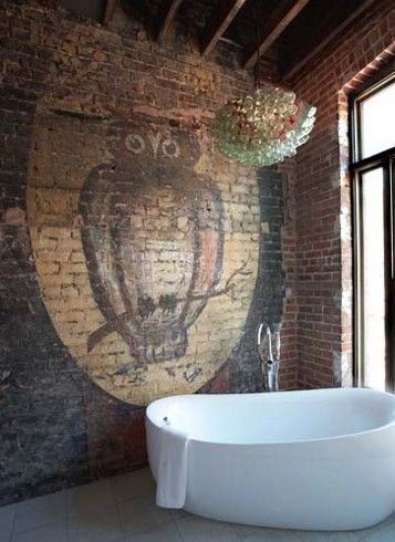 "My Bohemian Home ~ Bathrooms and Powder Rooms  This tub is more sleek and modern than I usually like, but in this rustic bathroom, I think it works. And I don't know about you, but that owl mural on the raw brick wall just screams ""bohemian"" to me."