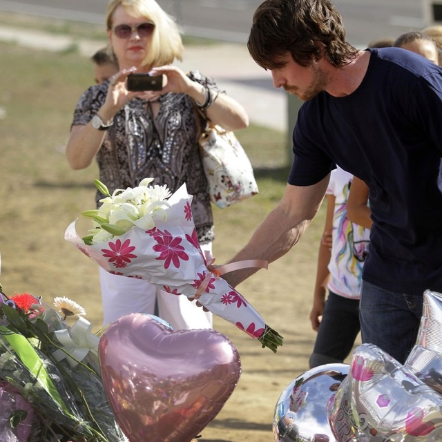 Christian Bale visiting memorial for the shooting victims in Denver.  This is why I love this guy! xxxx: Bale Places, Places Flowers, Bale Visit, Shoots Victim, Christian Bale, Movie Theater, Mass Shoots, Actor Christian, Dark Knights