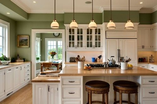 sage walls, white cabinets, butcher block -- like the color scheme