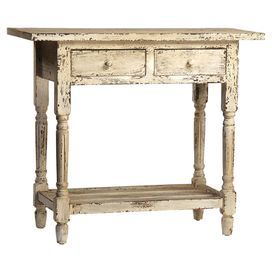 "Evoking classic American with its warmly weathered finish and fluted columns, this side table features two drawers and a lower shelf.  Product: Side tableConstruction Material: Asian fir and MDFColor: Distressed whiteFeatures: Two drawersDimensions: 31"" H x 35"" W x 17"" DCleaning and Care: Dust with a soft cotton cloth"