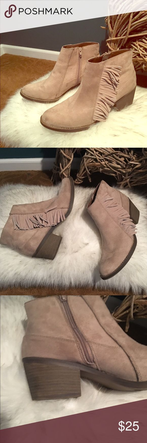 Cream Boots Cream swede cream ankle boots with fringe on each side. A 2 inch heel and a zipper up the inside. Shoes Ankle Boots & Booties