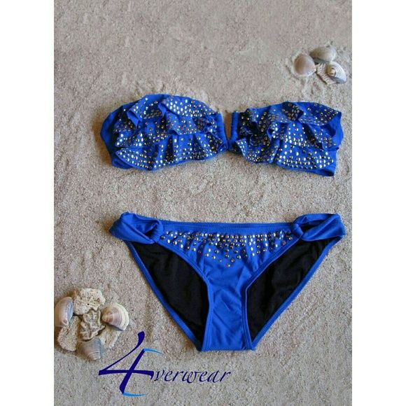 Meet your Posher, 4Everwear ROYAL BLUE RUFFLE BANDEAU BIKINI 4Everwear this sensational removable strap bikini the way you like it.The bandeau top  features gold tone studs accented on layered  ruffles, a V shaped cut out design for more sex  appeal and ties at the back. To add more glam, the alluring bottom has side hip peek a boo cut outs and several rows of gold tone studs. This stunning two piece combination is a perfect match made for styling and profiling pool side or on the beach…