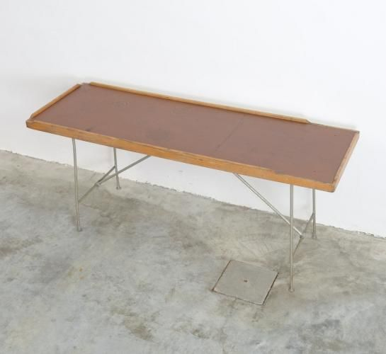 This Industrial Folding Table Was Manufactured Around 1947. The Metal Base  Is Silver Lacquered. The Wooden Top Is Covered With Original Brown Linoleum.