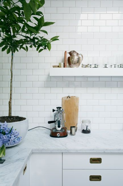 white subway tiles, marble countertops.