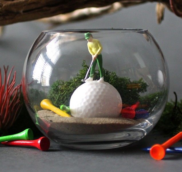 This kit contains everything you need to create a no fuss magical world in a mini glass terrarium with its own little Golfer. New for 2015 we are introducing the latest of our terrarium mini worlds needing absolutely no attention once assembled. A golfer balances on a giant golf ball to take his shot surrounded by fallen tees. Our fascinating kits come complete with glass terrarium, sand, preserved moss, plastic golf tees, miniature golfer, golf ball and glue and full instructions on how…