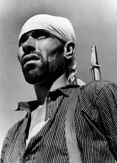 Republican soldier on the Aragon front near Huesca, Spain. August 1936, by Robert Capa